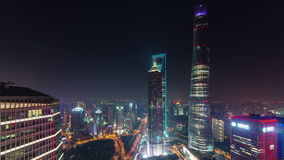 Night cityscape shanghai downtown roof top panorama 4k time lapse china. China night illumination cityscape shanghai downtown roof top panorama 4k time lapse stock video footage