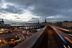 Night cityscape of Slussen, central Stockholm. An early evening cityscape, featuring Slussen and Old Town, in Stockholm, Sweden. Motion over the train to royalty free stock photos