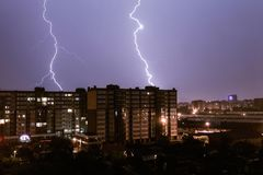 Night cityscape of storm. With lightning Stock Images