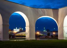 Night cityscape of the Veliky Novgorod, Russia. Kremlin and St Sophia cathedral in the arch spans of Yaroslav courtyard. Arcade in Veliky Novgorod, Russia Stock Photo