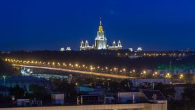 Night cityscape view of Moscow timelapse. View from rooftop to the main building of Moscow State University at night stock video footage