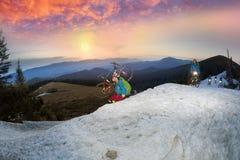 Night climbing bicycle racer Stock Photo