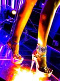 At the night club. Pretty woman legs on the glassy night club floor Stock Image