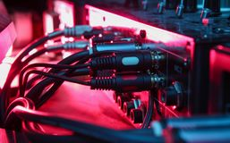 Night club concept. Audio mixer with wires close up. neon light royalty free stock photos