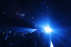 Night club crowd in front of bright  stage lights Royalty Free Stock Photos