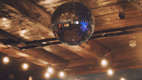 Night club - disco ball at ceiling Stock Photos
