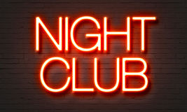 Night club neon sign on brick wall background. Stock Image