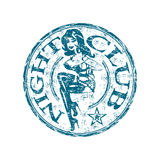 Night club rubber stamp. Blue grunge rubber stamp with attractive young woman silhouette and the text night club written inside the stamp Stock Photos