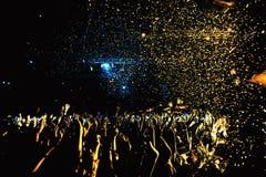 Night club silhouette crowd in confetti Royalty Free Stock Photo