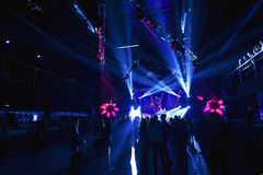 Night club silhouette crowd in front of bright stage lights Stock Photography
