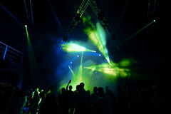Night club silhouette crowd in front of bright stage lights Stock Image
