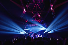 Night club silhouette crowd in front of bright stage lights Royalty Free Stock Photo