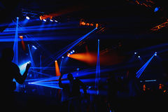 Night club silhouette crowd in front of bright stage lights Royalty Free Stock Images