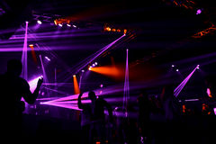 Night club silhouette crowd in front of bright stage lights Royalty Free Stock Photography