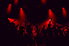 Night club silhouette crowd in front of bright stage lights. Cheering night club crowd in front of  stage lights Stock Photography