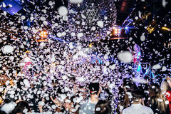Night club silhouette crowd hands up at confetti steam stage Royalty Free Stock Photography
