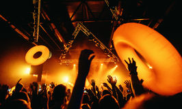 Night club silhouette crowd hands up with fly entertanment. Cheering night club crowd at concert Stock Photo