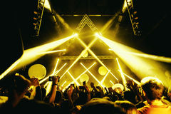 Night club silhouette crowd hands up with fly entertanment Stock Image
