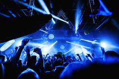 Night club silhouette crowd hands up with fly entertanment. Cheering night club crowd at concert Stock Photography