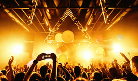 Night club silhouette crowd hands up with fly entertanment. Cheering night club crowd at concert Stock Images