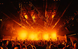 Night club silhouette crowd hands up at stage. Cheering night club crowd at concert Royalty Free Stock Images
