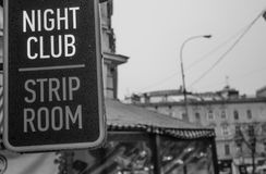 Signboard of a night club with striptease. Night club. Striptease club in the European city. Men`s entertainment. Leisure in the evening Stock Photo
