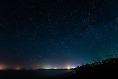 Night coast and star trails Stock Photo