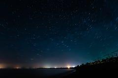 Night coast and star trails Stock Photo