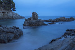 Night coastal shot with rocks, long exposure picture from Costa Royalty Free Stock Images