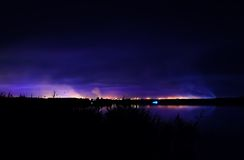 Night coastline, view on the town of Kryvyi Rig from the river. Royalty Free Stock Photos