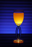 Night coctail. Yellow night coctail with blue background Royalty Free Stock Photo