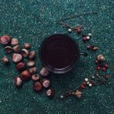 Night Coffee flatlay with chestnuts, acorn and fantasy berries forrest necklage Royalty Free Stock Photos