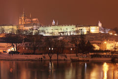 Night colorful romantic snowy Prague gothic Castle above River Vltava, Czech republic Royalty Free Stock Photography
