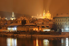Night colorful romantic snowy Prague St. Nicholas' Cathedral, Czech republic Royalty Free Stock Photo