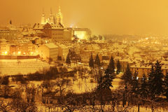 Night colorful snowy Prague City with gothic Castle, Czech republic Royalty Free Stock Images