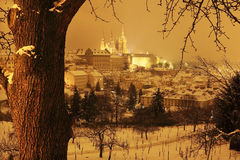 Night colorful snowy Prague City with gothic Castle, Czech republic Royalty Free Stock Photo