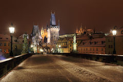 Night colorful snowy Prague gothic Castle from Charles Bridge Royalty Free Stock Image