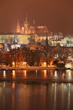 Night colorful snowy Prague gothic Castle with Charles Bridge, Czech Republic Royalty Free Stock Photography