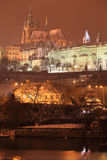 Night colorful snowy Prague gothic Castle, Czech Republic Royalty Free Stock Photos