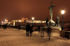 Night colorful snowy Prague gothic Castle with Sculptures from the Charles Bridge, Czech republic Stock Photography