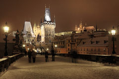 Night colorful snowy Prague gothic Castle with Sculptures from the Charles Bridge Royalty Free Stock Photography