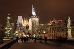 Night colorful snowy Prague gothic Castle with Sculptures from the Charles Bridge Stock Photography