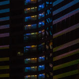 Night colorful windows lights of the high-rise residential building in city sleeping area Stock Photo