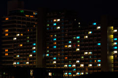 Night colorful windows lights in residential building. Night colorful windows lights of the high-rise residential building in city sleeping area stock image