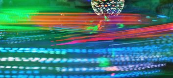 Disco lights synth wave vapor neon funfair fairground ride, Night colors of the amusement park lo-fi royalty free stock photo