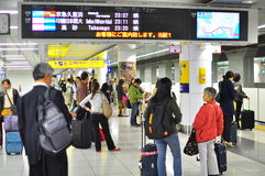 Night commute on the subway. Travellers arrived in Haneda Airport Tokyo at night, travel to their accommodation by subway Stock Photo
