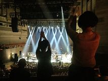 A night in concert. People are dancing in their seats during the concert Royalty Free Stock Images