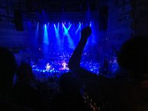 A night in concert. People are dancing in their seats during the concert Royalty Free Stock Photo