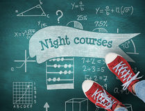 Night courses against green chalkboard Stock Image