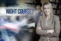 Night courses against professor looking at camera with arms folded Stock Image